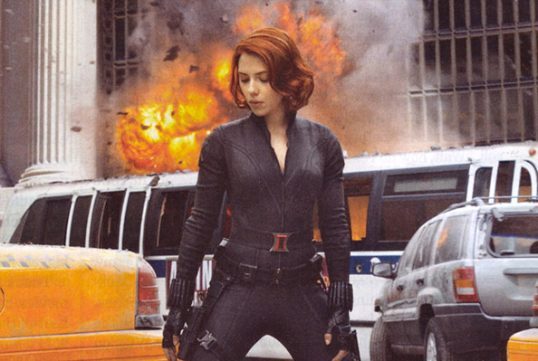 Scarlett Johansson chillin in front of some explosions