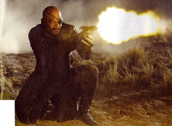 Sam Jackson shooting a pistol with a massive muzzle flare